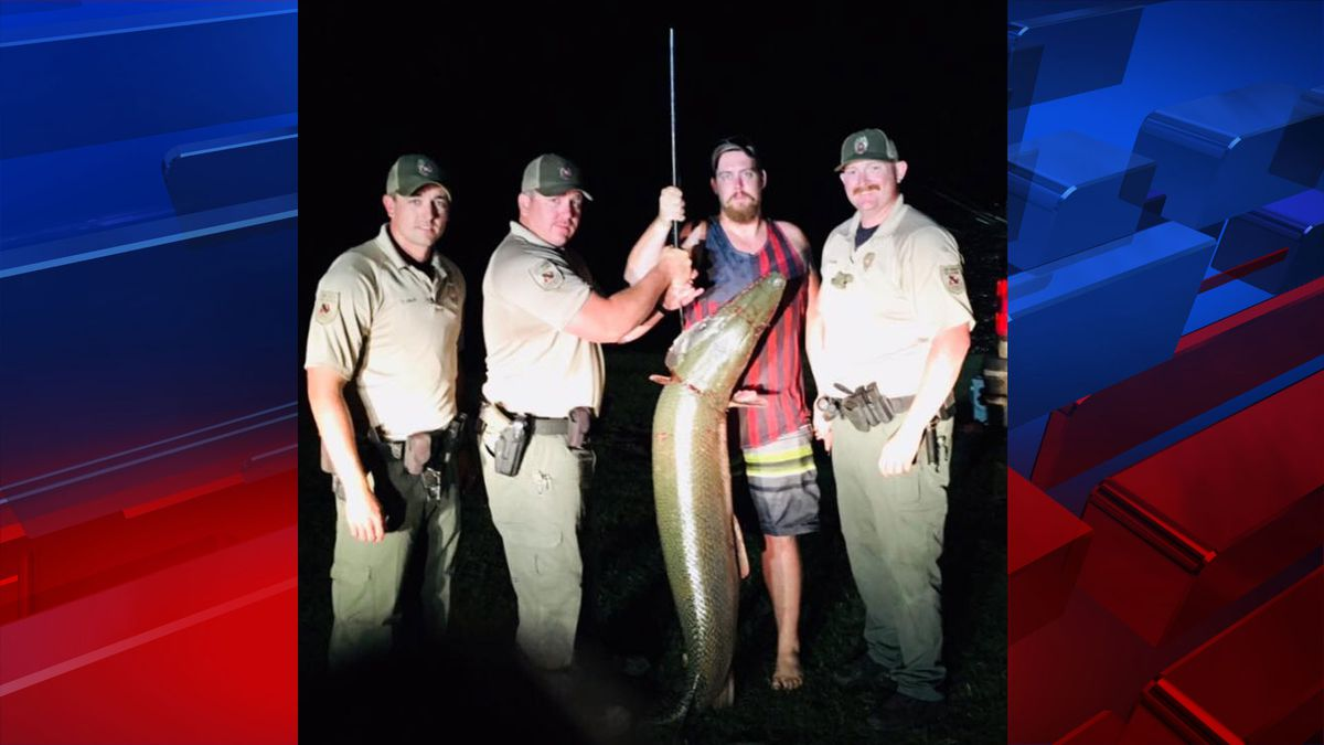 Lake Texoma Game Wardens T. Hale , B. Walker and T. Runyan and fisherman Tim Butler (Oklahoma Game Wardens).