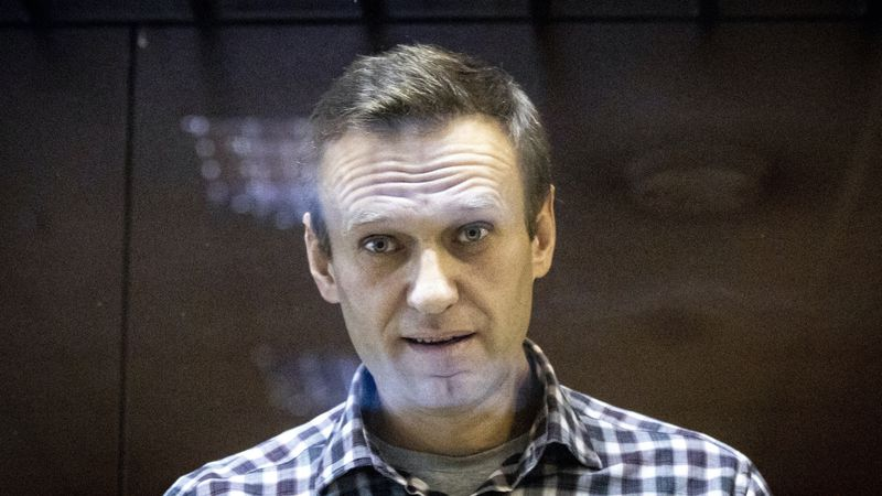 In this Saturday, Feb. 20, 2021, file photo, Russian opposition leader Alexei Navalny looks at...