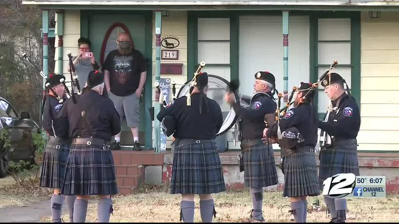 Sherman Police Regional Bagpipe Band plays music for a Sherman woman and husband in quarantine...