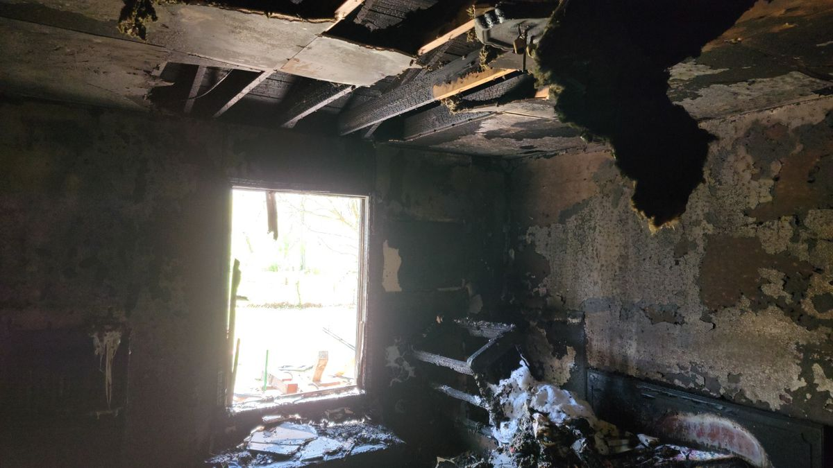 The fire was contained to the back bedroom of the house.