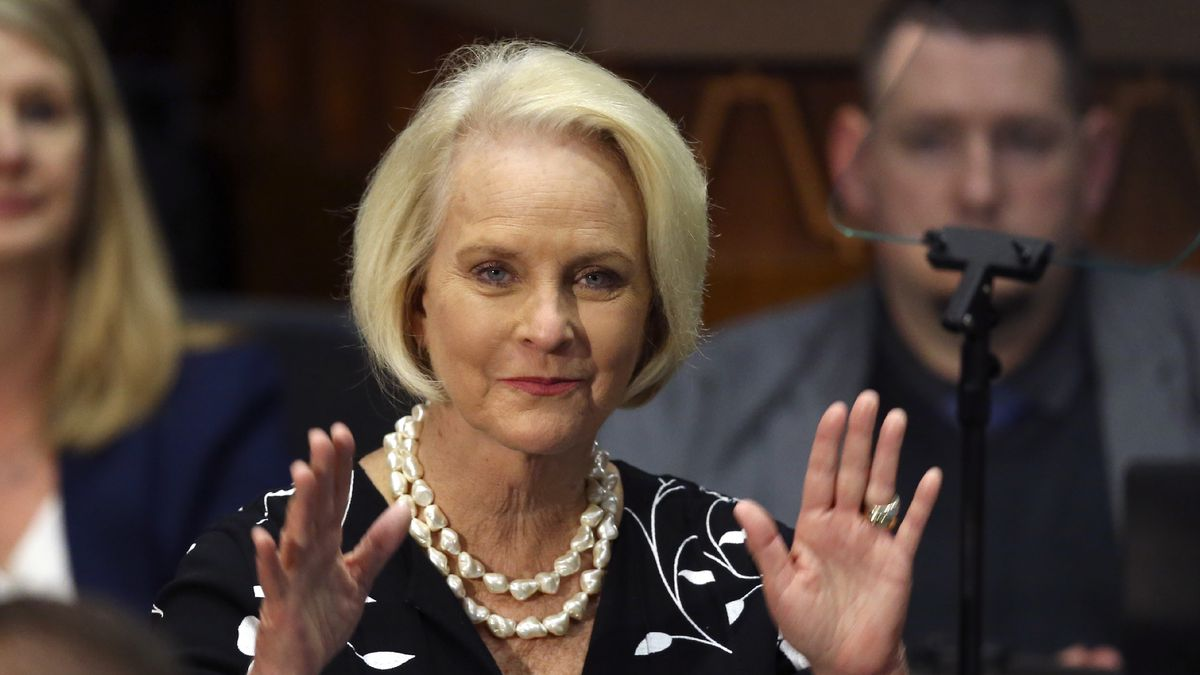 In this Jan. 13, 2020, file photo Cindy McCain, wife of former Arizona Sen. John McCain, waves to the crowd after being acknowledged by Arizona Republican Gov. Doug Ducey during his State of the State address on the opening day of the legislative session at the Capitol in Phoenix. Cindy McCain is going to bat for Joe Biden, lending her voice to a video set to air on Tuesday, Aug. 18, during the Democratic National Convention programming focused on Biden's close friendship with her late husband, Sen. John McCain.