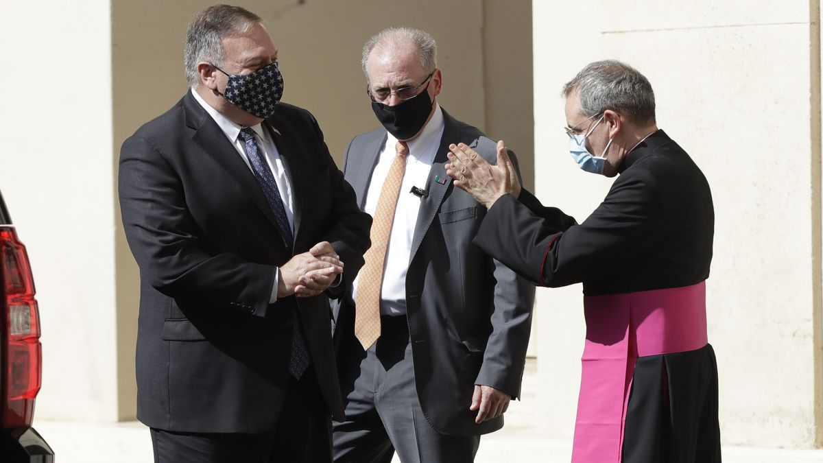 U.S. Secretary of State Mike Pompeo, left, is greeted by Monsignor Joseph Murphy, head of Vatican protocol, after meeting Vatican Secretary of State Cardinal Pietro Parolin, at the Vatican, Thursday, Oct. 1, 2020.