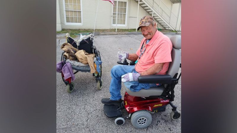 Ricky is with his new electric wheel chair.