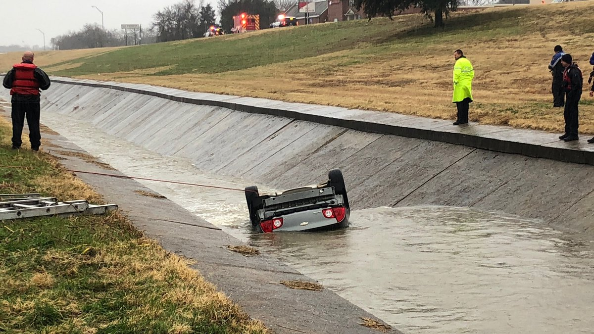 Crews are working to remove a car that flipped into a ditch Thursday afternoon in Sherman.