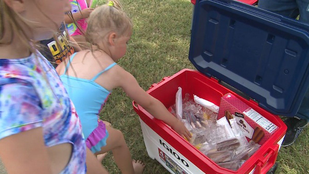Dozens came by as soon as they opened their cooler of treats.