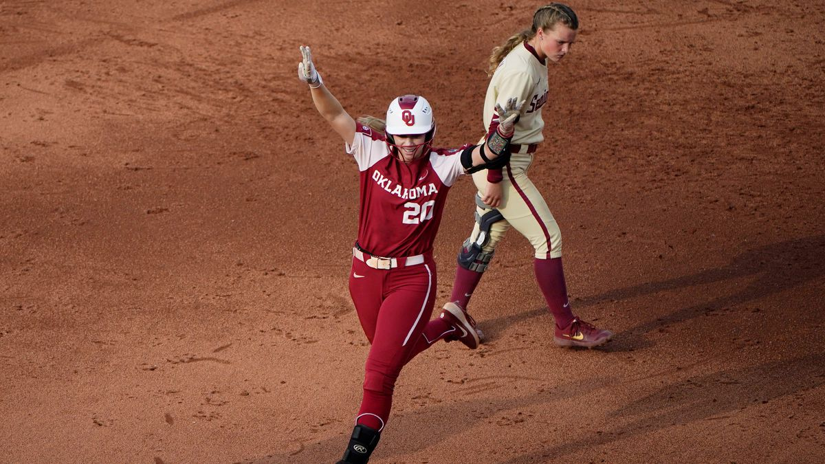Oklahoma's Jana Johns (20) celebrates as she runs past Florida State's Josie Muffley, right, on...