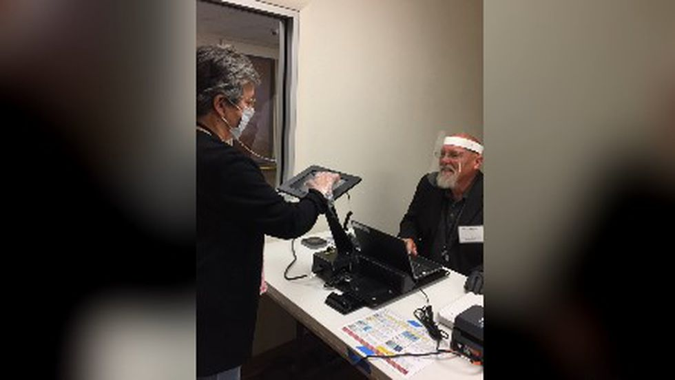 Grayson County Election Administration demonstrates how face masks and gloves are being used to keep voters and employees safe.