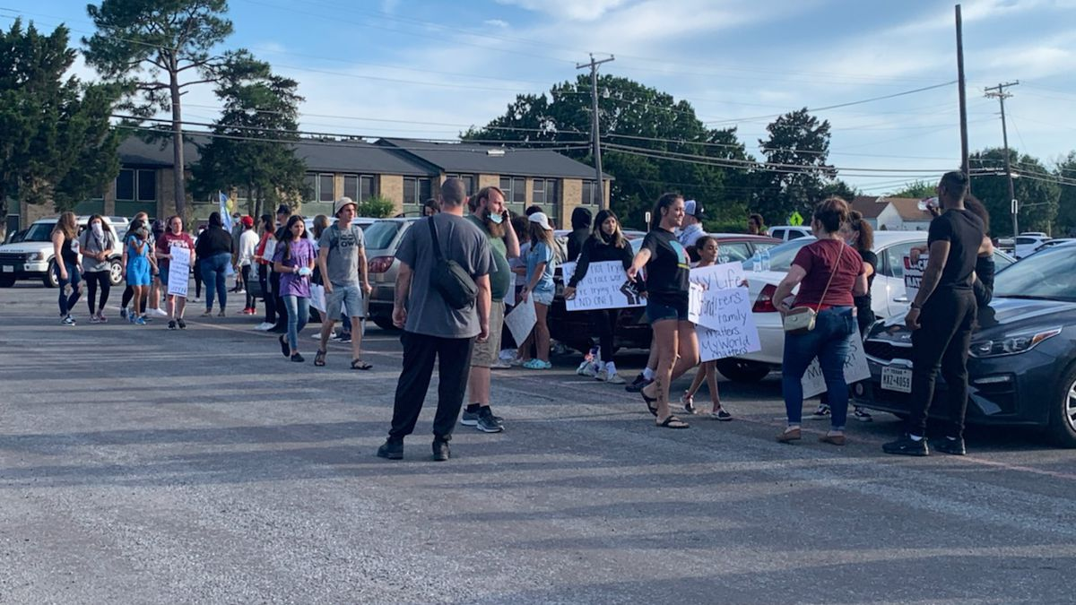 Hundred of people came together in Sherman Sunday evening to protest the death of George Floyd, a black man who died one week ago after a Minneapolis police officer pressed his knee to Floyd's neck until he stopped breathing.