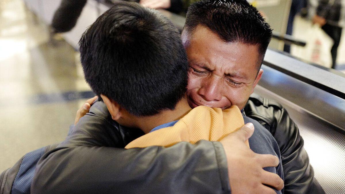 In this Wednesday, Jan. 22, 2020, file photo, David Xol-Cholom, of Guatemala, hugs his son...