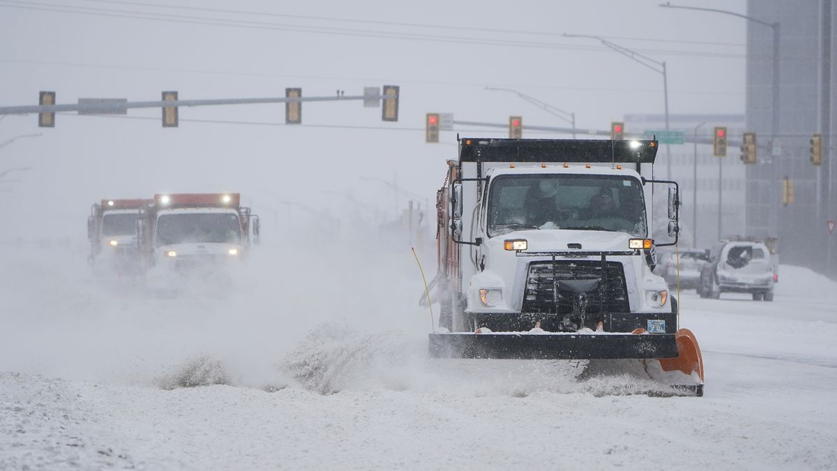 Snowplows work to clear the road during a winter storm on Sunday, Feb. 14, 2021, in Oklahoma...