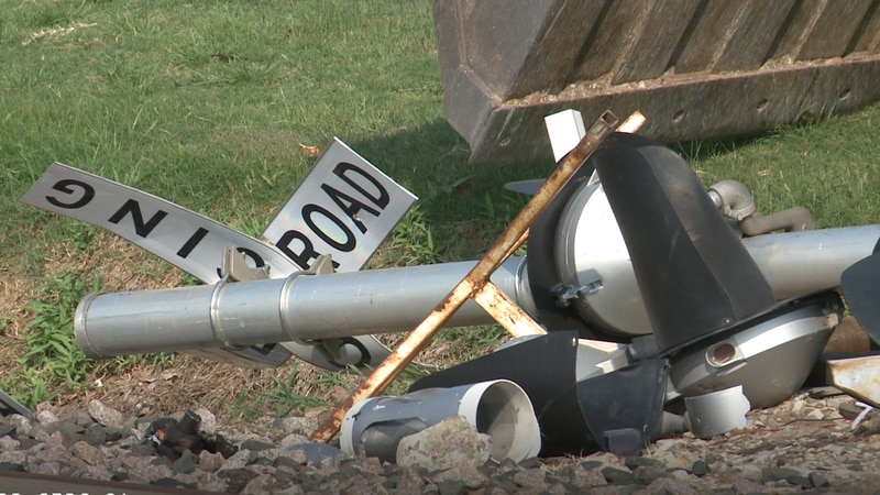 Damage from a collision between a semi-truck and a train.