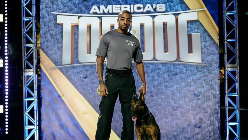 Two members of the Sherman Police Department, Jaeger, the Belgian Malinois, and his trainer...