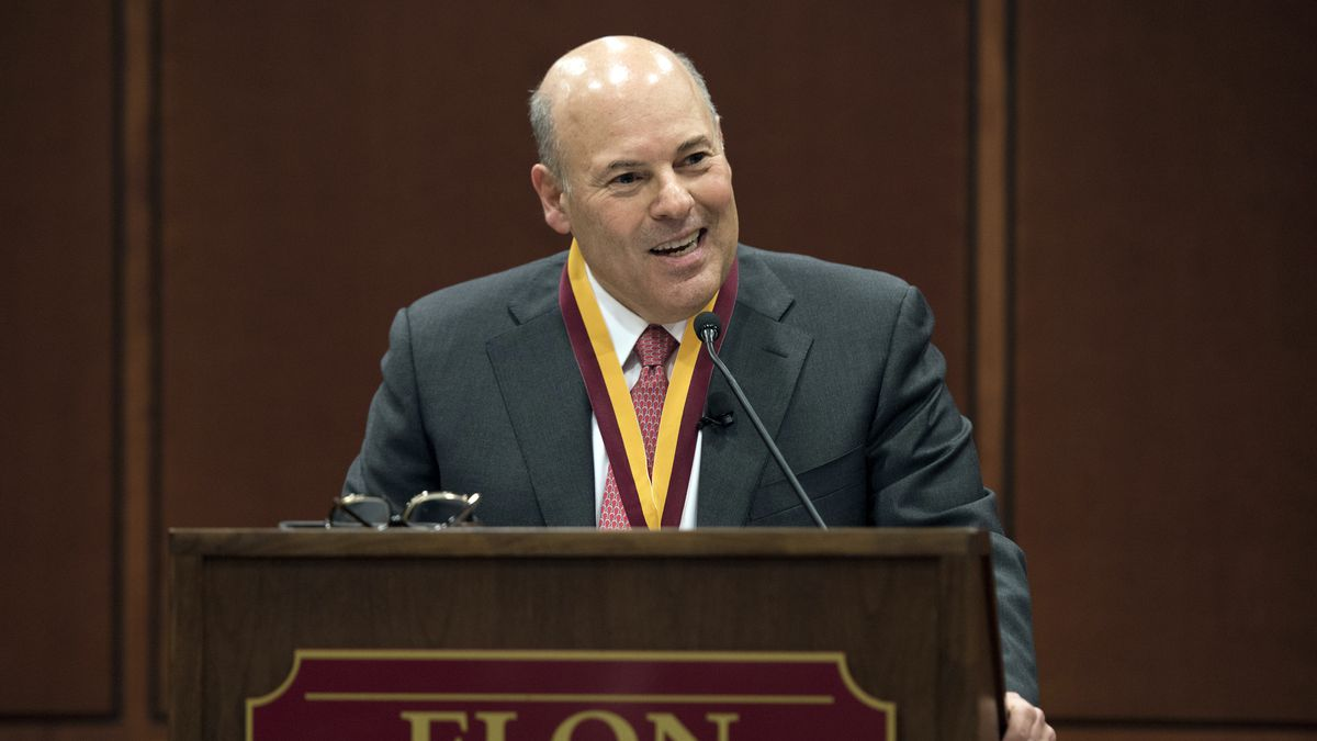 In this March 1, 2017, file photo, then Elon Trustee Louis DeJoy is honored with Elon's Medal for Entrepreneurial Leadership in Elon. N.C. U.S. Sen. Joe Manchin and union officials say the U.S. Postal Service is considering closing post offices across the country, sparking worries ahead the anticipated surge of mail-in ballots in the 2020 elections. Manchin on Wednesday, July 29, 2020 said he has received numerous reports from post offices and colleagues about service cuts or looming closures in West Virginia and elsewhere, prompting him to send a letter to Postmaster General Louis DeJoy asking for an explanation.