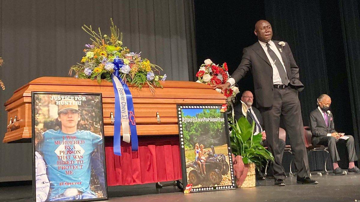 Attorney Ben Crump stands next to Hunter Brittain's casket at the Beebe High School Auditorium...