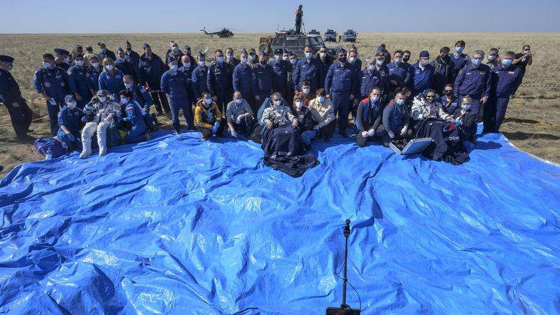 Expedition 64 NASA astronaut Kate Rubins, left, Roscosmos cosmonaut Sergey Ryzhikov, center,...