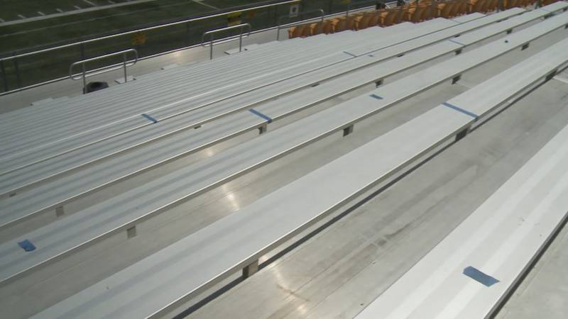 Bleachers are marked with tape to encourage fans to maintain social distancing.