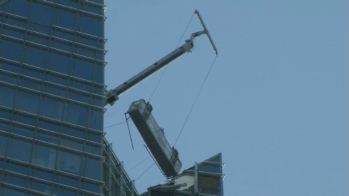 Two window washers were rescued from a scaffold outside the 50-floor Deon Tower.