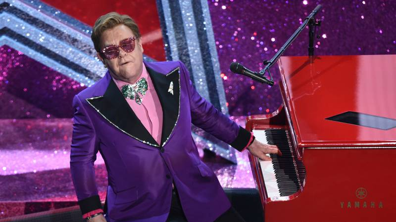 """FILE - In this Sunday, Feb. 9, 2020 file photo, Elton John performs """"(I'm Gonna) Love Me Again""""..."""
