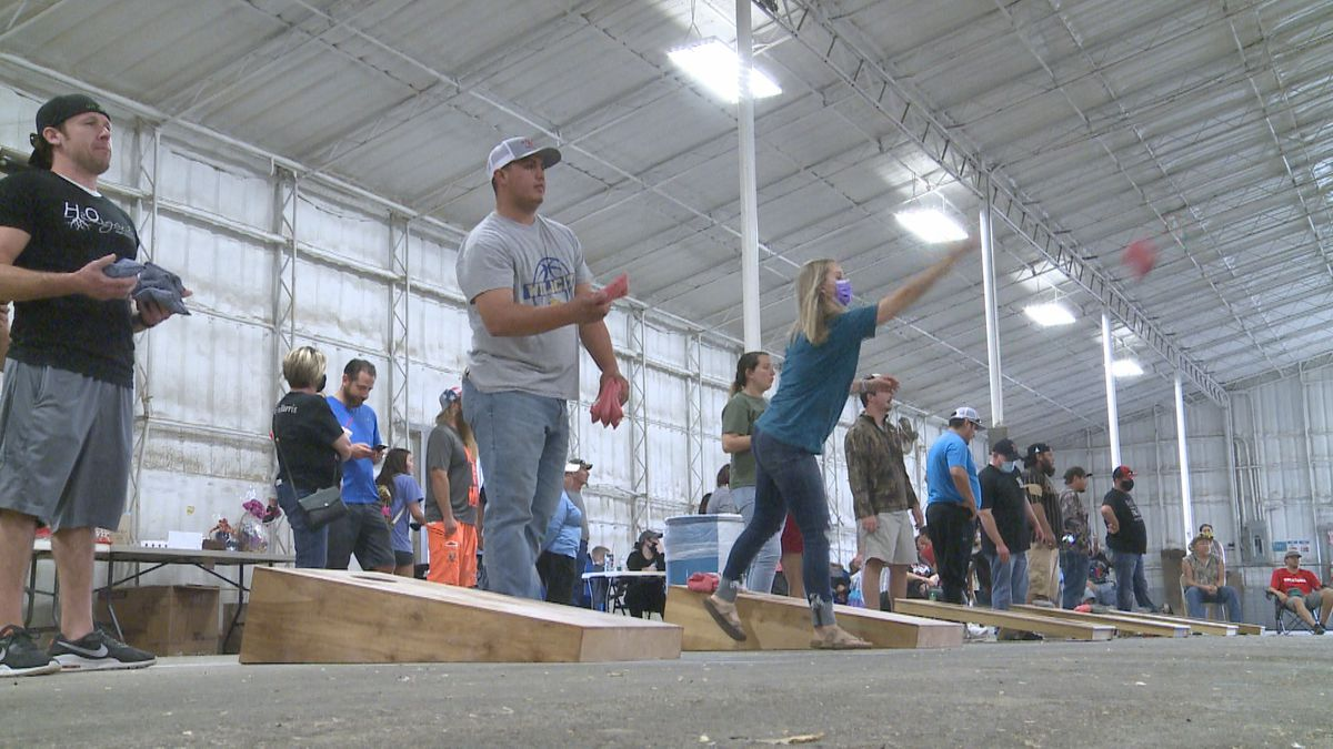 A cornhole tournament in Marietta brought community members together to raise money for a...