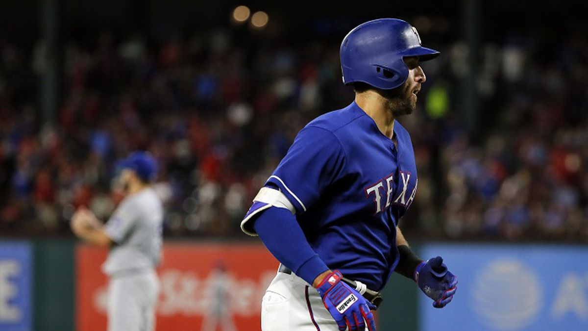 Texas Rangers' Joey Gallo jogs home after hitting a solo home run off Kansas City Royals starting pitcher Nathan Karns, rear, during the fifth inning of a baseball game in Arlington, Texas, Friday, April 21, 2017. The homer was Gallo's second of the game. (AP Photo/Tony Gutierrez)