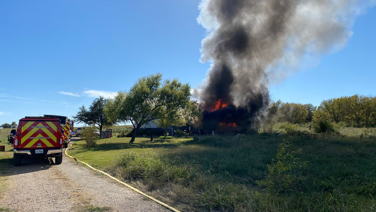 At least three fire departments were called to the scene of a Pottsboro house fire Tuesday...