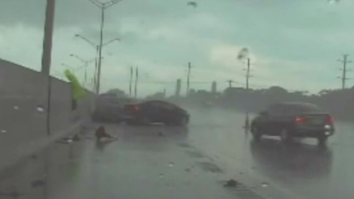 Dashcam video shows a car nearly crushing a Florida Highway Patrol trooper on the side of the...