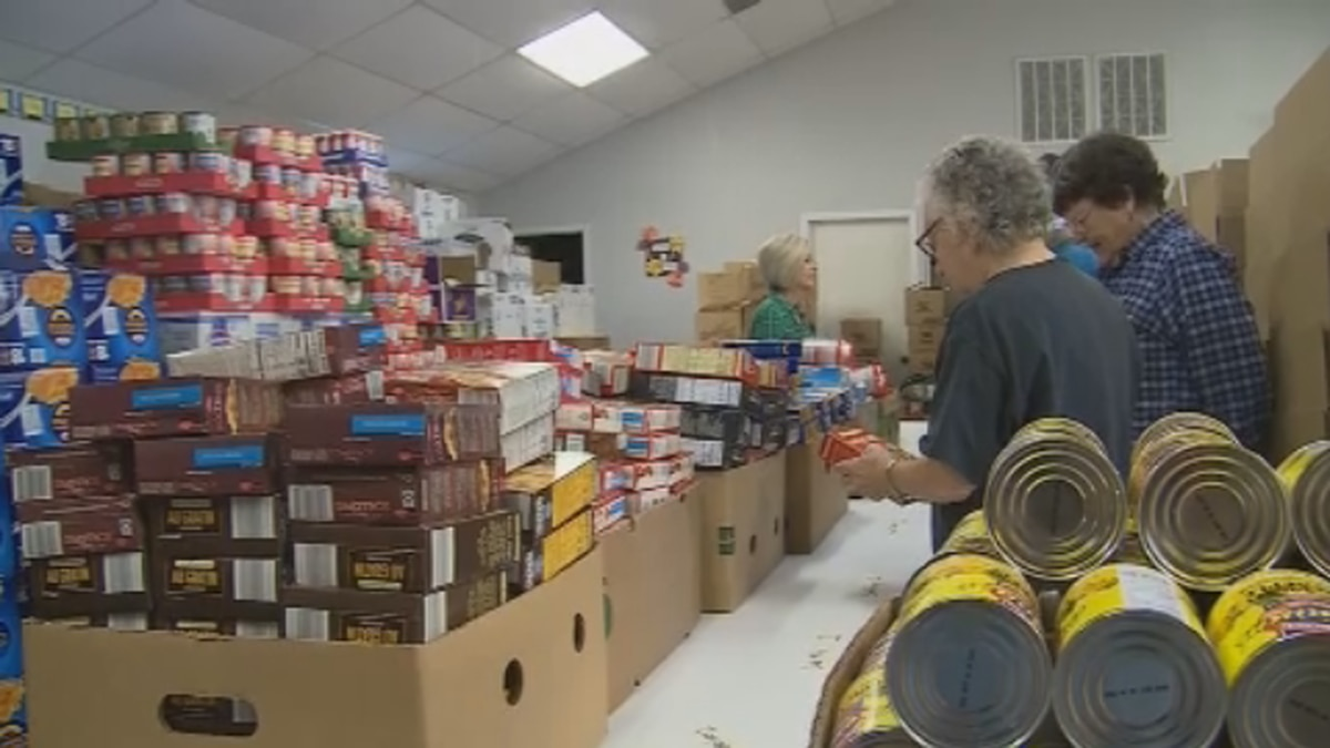 Several Grayson County food pantries came together on Tuesday to pack Thanksgiving food boxes...