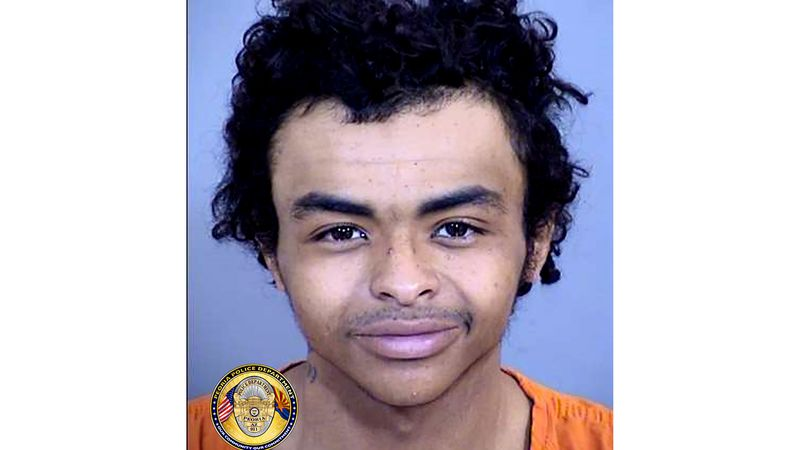 This undated photo provided by the Peoria Police Department, shows Ashin Tricarico, who is...