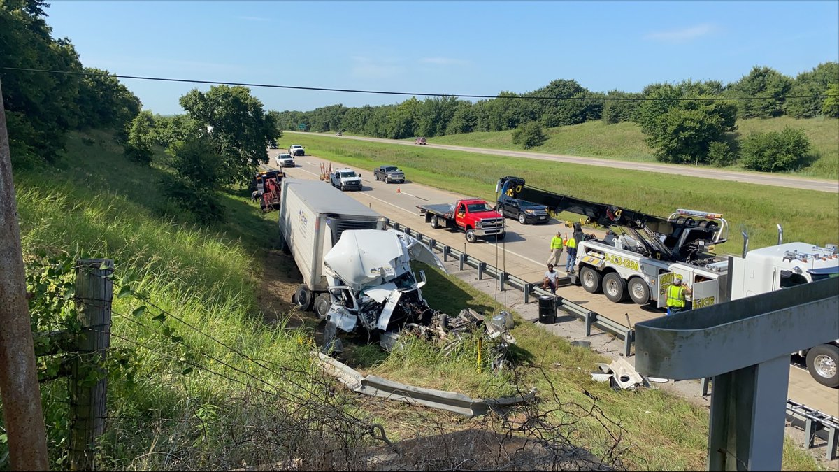 A semi truck rolled over and crashed into a bridge Tuesday morning on Interstate 35 near...