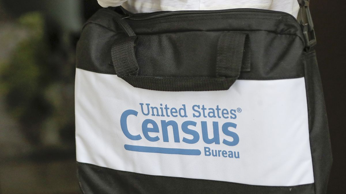 A briefcase of a census taker is seen as she knocks on the door of a residence Tuesday, Aug. 11, 2020, in Winter Park, Fla. A half-million census takers head out en mass this week to knock on the doors of households that haven't yet responded to the 2020 census.