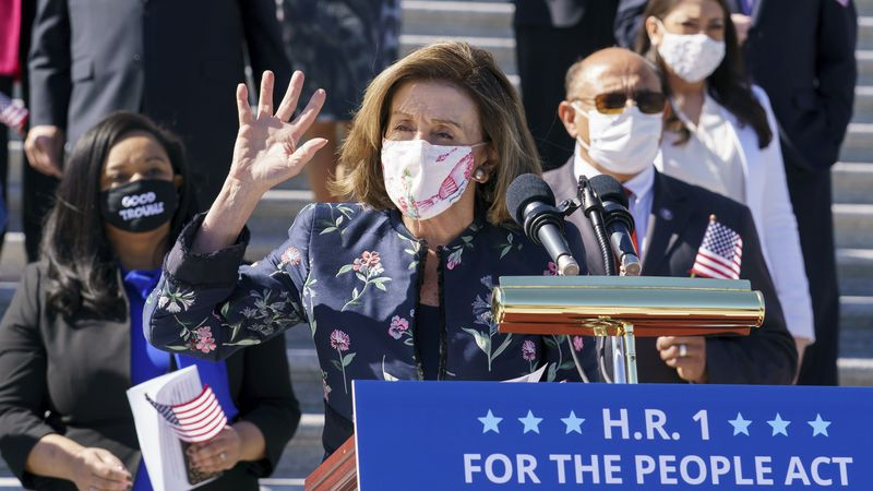 Speaker of the House Nancy Pelosi, D-Calif., and the Democratic Caucus gather to address...