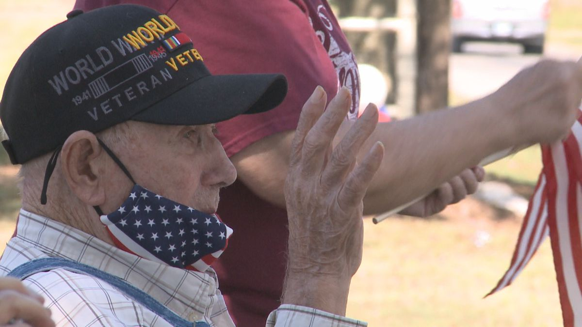 A Marietta Navy WWII veteran celebrates his 97th birthday during a drive-by parade.