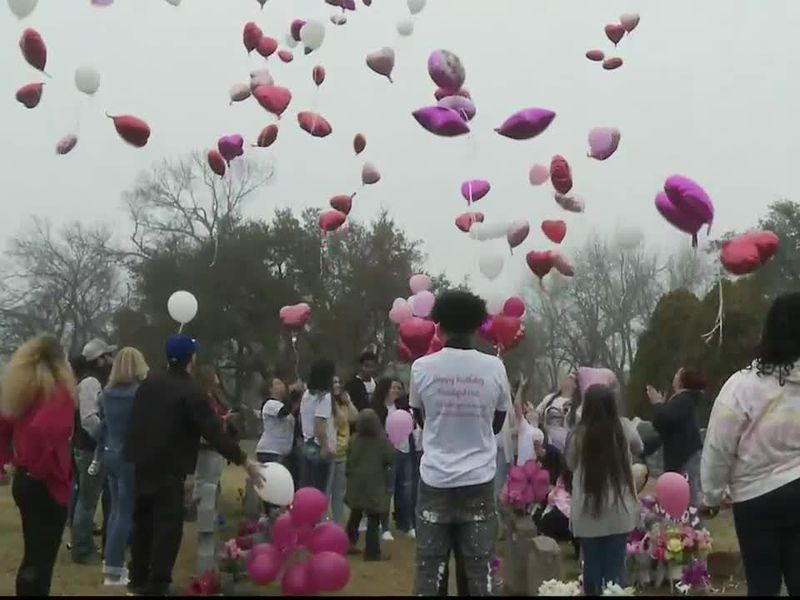 Family of three-month-old infant Lyrik holds a balloon release ceremony in honor of Lyrik's...