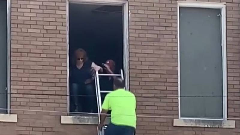 Reba McEntire rescued from second story building window in downtown Atoka after stairs of...