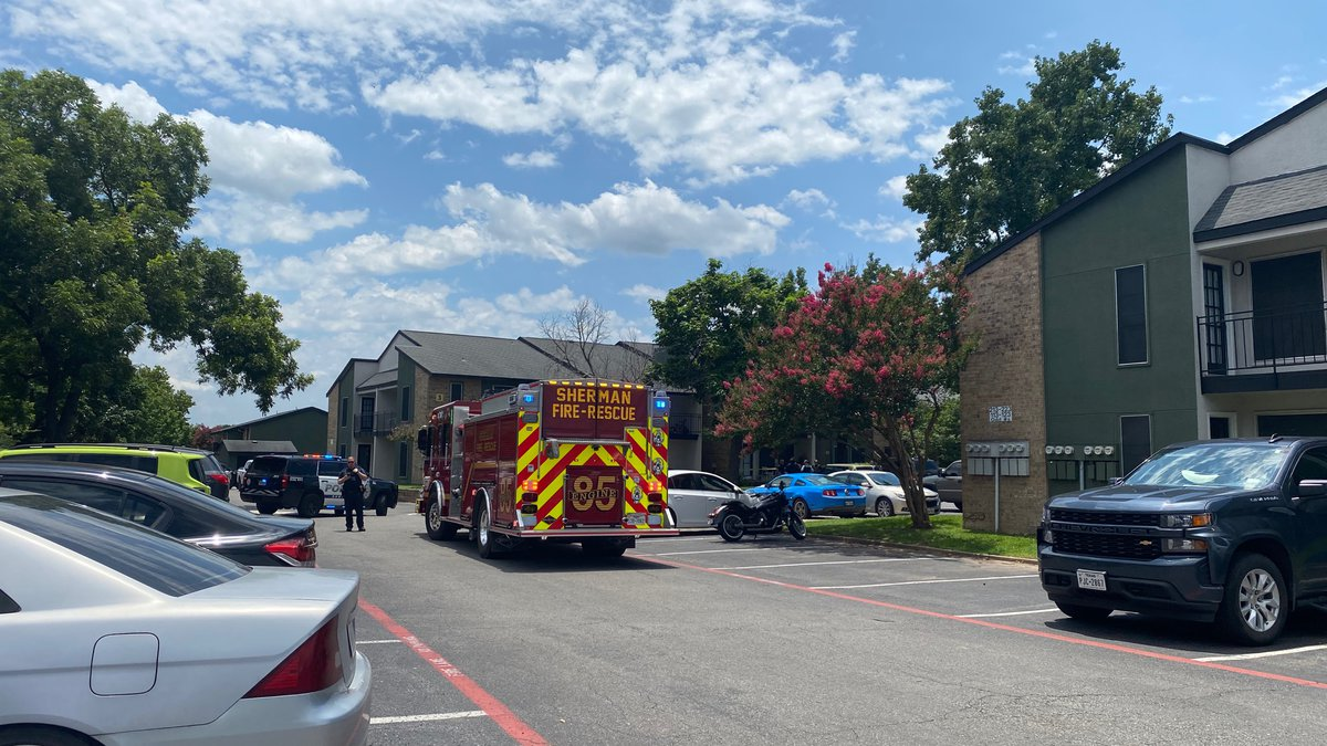Police and emergency personnel respond to the Parkview Apartments in Sherman on Monday, July...