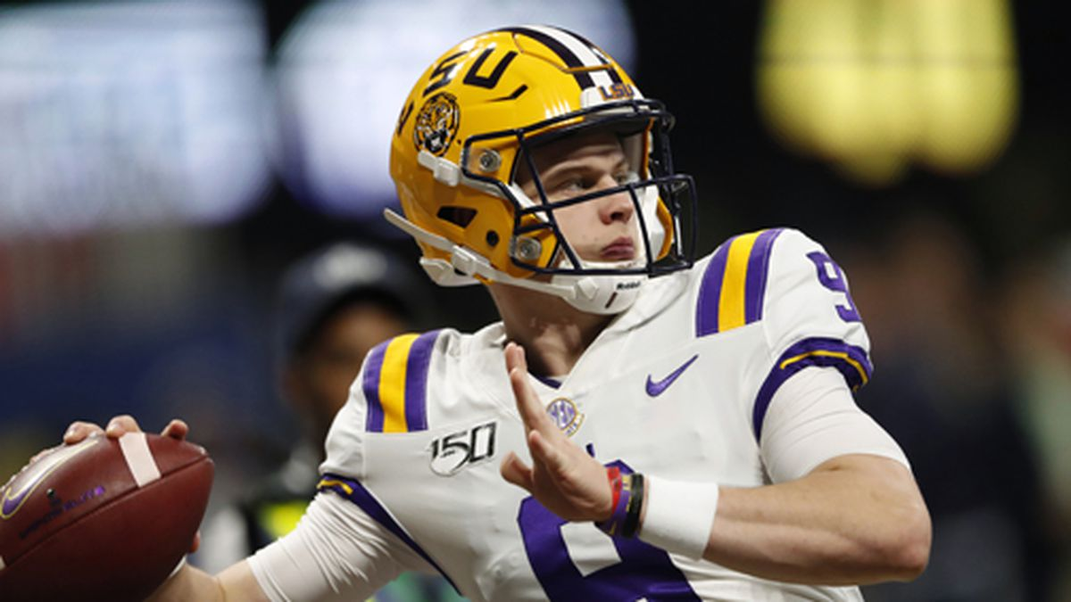 In this Dec. 7, 2019, file photo, LSU quarterback Joe Burrow (9) warms up before the Southeastern Conference championship NCAA college football game against Georgia, in Atlanta. (AP Photo/John Bazemore, File)