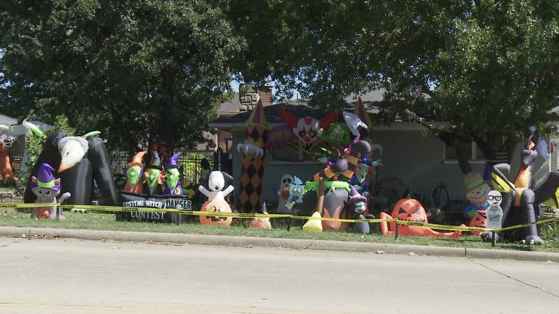 A Denison family decorates their home with dozens of inflatables every year for Halloween.